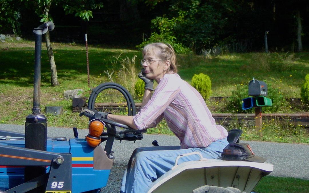 Carol driving tractor